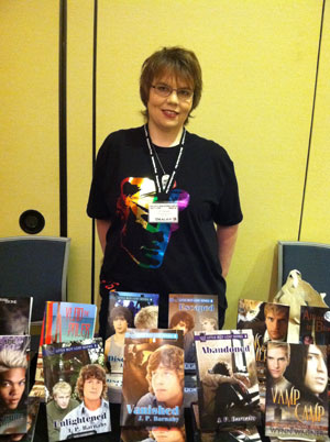 J. P. Barnaby with her books set up at OutlantaCon in Atlanta