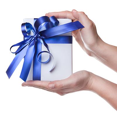 Hands holding a gift wrapped in white paper with a blue bow